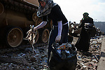 Egyptian volunteers pick up garbage left over from 18 days of protest in the area around Tahrir Square February 12, 2011 in Cairo, Egypt. The day after the revolution toppled the regime of President Hosni Mubarak, Egyptians continued to celebrate and began to focus on rebuilding their city and society. .(Photo by Scott Nelson)