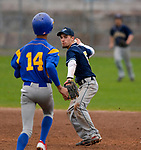 TORRINGTON, CT-042017JS12- Wolcott Tech's Mitchell Sorenson (5) throws to first to complete the double play after getting Harding's Joel Olivo (14) out on a force play at second base during their game Wednesday at Fuessenich Park in Torrington. <br /> Jim Shannon Republican-American