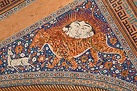"""Detail of solar tiger mosaic, Sher-Dor Madrasah, 1619-36, Samarkand, Uzbekistan, pictured on July 15, 2010. The Sher-Dor Madrasah, commissioned by Yalangtush Bakhodur as part of the Registan ensemble, and designed by Abdujabor, takes its name, """"Having Tigers"""", from the double mosaic (restored in the 20th century) on the tympans of the portal arch showing suns and tigers attacking deer. Samarkand, a city on the Silk Road, founded as Afrosiab in the 7th century BC, is a meeting point for the world's cultures. Its most important development was in the Timurid period, 14th to 15th centuries. Picture by Manuel Cohen."""