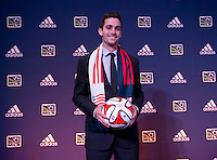 #4 overall pick Steve Neumann of the New England Revolution stands on the podium during the MLS SuperDraft at the Pennsylvania Convention Center in Philadelphia, PA, on January 16, 2014.