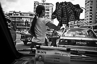 A street scene viewed through a taxi in Yangon, Myanmar.