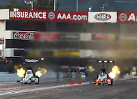 Feb 11, 2017; Pomona, CA, USA; NHRA top fuel driver Antron Brown (left) races alongside Doug Kalitta during qualifying for the Winternationals at Auto Club Raceway at Pomona. Mandatory Credit: Mark J. Rebilas-USA TODAY Sports
