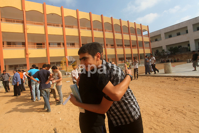 Palestinian friends Hug their secondary school students after find their results in Gaza city on July 19, 2012. The Ministry of Education in Gaza Strip and the West Bank announced the results together. Photo by Ashraf Amra