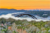 Fog rises from the warmer waters underneath Pennybacker Bridge (the 360 Bridge) with the city of Austin in the distance. I'd been trying to get this shot for several years and finally found a very cold, calm morning to capture this image of the 360 Bridge with Austin in the background.
