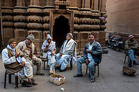 Indan old men drinks tea in front of a temple in Varanasi, Uttar Pradesh, India.