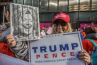 NEW YORK,NY October 29,2016. A woman holds banners supporting Trump, during  a rally for Donald Trump outside of Trump Tower in Manhattan, October 29,2016. Photo by VIEWpress/Maite H. Mateo