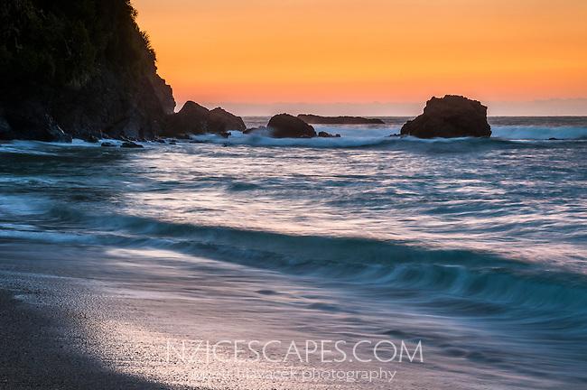 Remote, wild West Coast beach at sunset, South Westland, West Coast, New Zealand
