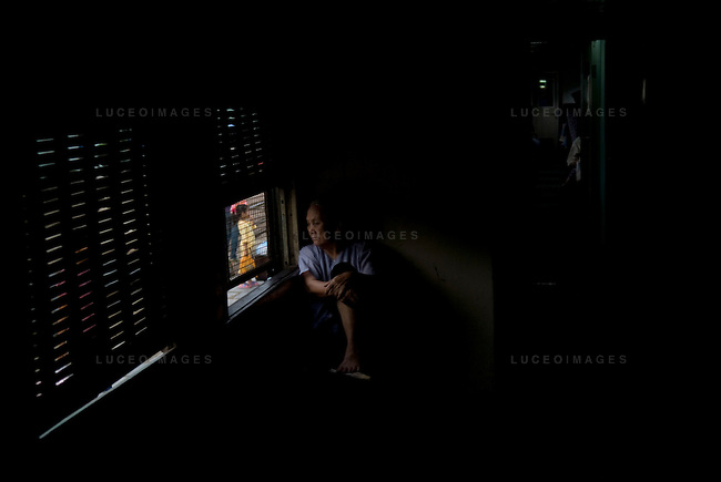 A woman looks out of a window on a train from Hanoi to Sapa in Vietnam.