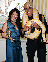 BEVERLY HILLS, CA, USA - MARCH 28: Vikki Lizzi, KUBA Ka at the Versace Unveiling Of The 1st Pop Recording Artist Superhero - KUBA Ka's Performance Outfits. Designed by the legendary fashion hosuse - Donatella Versace. For the Benefit of the Face Forward Foundation (Plastic Surgery for Destroyed Faces from Violence). Pop entertainer TV personality KUBA Ka, together with VERSACE, unveiled Kuba Ka's new Versace images, for the First Pop Artist/Superhero of the World. He has become the inspiration of Donatella's newest and wildest creations and will celebrate the launch of his new power house conglomerate - KUBA Ka Empire Inc. in collaboration with the sensational fashion house - VERSACE on Friday, his birthday at a red carpet media and celebrity event at the luxurious Peninsula Hotel in Beverly Hills held at the Peninsula Hotel on March 28, 2014 in Beverly Hills, California, United States. (Photo by Xavier Collin/Celebrity Monitor)