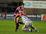 Tom James charges past Pieter Dixon. Cardiff Blues V Bath, EDF Energy Cup. &copy; Ian Cook IJC Photography iancook@ijcphotography.co.uk www.ijcphotography.co.uk