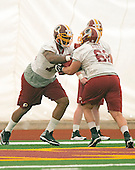 Offensive linemen Morgan Moses (76) of Virginia, left, and Trevita Stevens (62) of Utah, right, participate in a drill during the Washington Redskins' rookie minicamp at Redskins Park in Ashburn, Virginia on Saturday, May 17, 2014. <br /> Credit: Ron Sachs / CNP