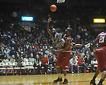"Ole Miss guard Chris Warren (12) shoots against Arkansas' Marshawn Powell (33) at C.M. ""Tad"" Smith in Oxford, Miss. on Saturday, March 5, 2010. Ole Miss won 84-74."