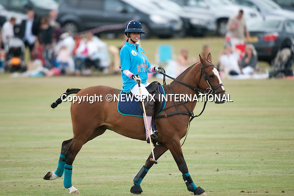 """Katie Price .Plays in 2010 Asprey World Class Cup Polo, played at Kenny Jones'Hurtwood Park, Surrey_England_17/07/2010..Mandatory Photo Credit: ©Dias/Newspix International..**ALL FEES PAYABLE TO: """"NEWSPIX INTERNATIONAL""""**..PHOTO CREDIT MANDATORY!!: NEWSPIX INTERNATIONAL(Failure to credit will incur a surcharge of 100% of reproduction fees)..IMMEDIATE CONFIRMATION OF USAGE REQUIRED:.Newspix International, 31 Chinnery Hill, Bishop's Stortford, ENGLAND CM23 3PS.Tel:+441279 324672  ; Fax: +441279656877.Mobile:  0777568 1153.e-mail: info@newspixinternational.co.uk"""