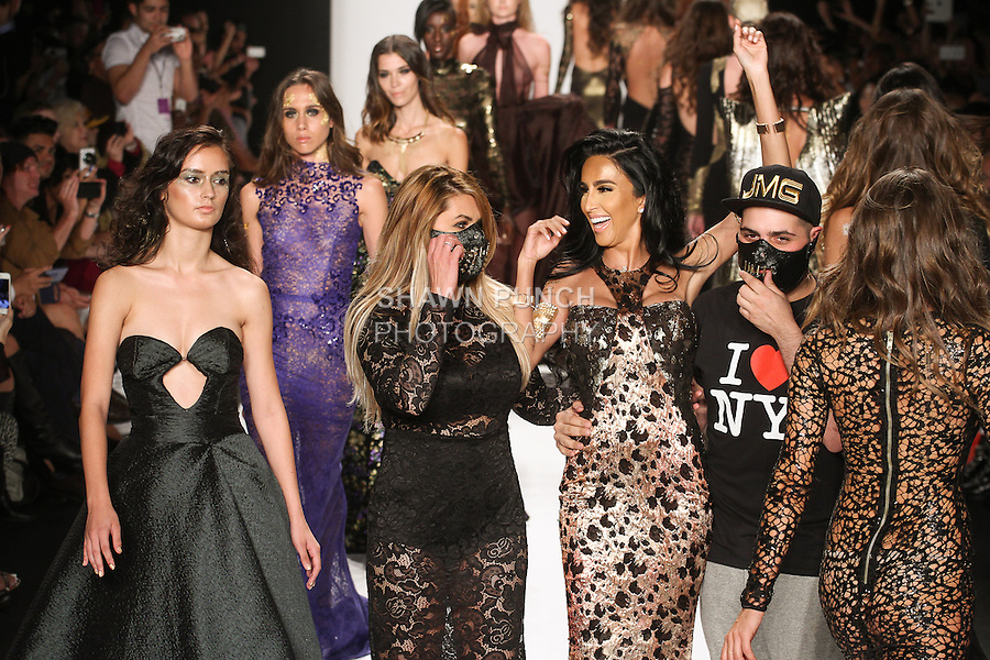 "Fashion designers and siblings Stepanie and Michael Costello walk runway with models for the close of the MTCostello Spring Summer 2015 ""Illuminati Collection"" runway show, for the Art Hearts Fashion Spring 2015 fashion show, during Mercedes-Benz Fashion Week Spring 2015 in New York City."