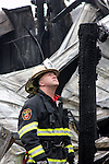 A Wauwatosa Fire Chief investigating the cause of a fire
