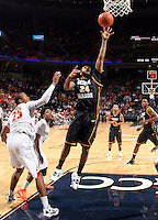 CHARLOTTESVILLE, VA- DECEMBER 6: Ryan Pearson #24 of the George Mason Patriots shoots next to Mike Scott #23 of the Virginia Cavaliers and Jontel Evans #1 of the Virginia Cavaliers during the game on December 6, 2011 at the John Paul Jones Arena in Charlottesville, Virginia. Virginia defeated George Mason 68-48. (Photo by Andrew Shurtleff/Getty Images) *** Local Caption *** Jontel Evans;Mike Scott;Ryan Pearson