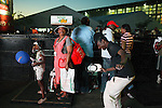 SOWETO, SOUTH AFRICA SEPTEMBER 23: People enjoy a concert on September 23, 2006 in Soweto, Johannesburg, South Africa. The concert was part of Soweto festival. Soweto is South Africa?s largest township and it was founded about one hundred years to make housing available for black people south west of downtown Johannesburg. The estimated population is between 2-3 million. Many key events during the Apartheid struggle unfolded here, and the most known is the student uprisings in June 1976, where thousands of students took to the streets to protest after being forced to study the Afrikaans language at school. Soweto today is a mix of old housing and newly constructed townhouses. A new hungry black middle-class is growing steadily. Many residents work in Johannesburg but the last years many shopping malls have been built, and people are starting to spend their money in Soweto.  .(Photo by Per-Anders Pettersson/Getty Images).