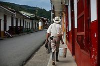A local resident walks in the town of Jardin in Antioquia August 1, 2012. Photo by Eduardo Munoz Alvarez / VIEW.