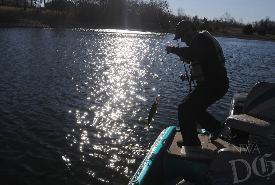 NWA Democrat-Gazette/FLIP PUTTHOFF <br /> Stein catches a black bass Feb. 17 2017 at Swepco Lake.