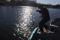 NWA Democrat-Gazette/FLIP PUTTHOFF <br /> Stein catches a black bass Feb. 17 2017 at Swepco Lake.