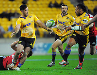 Ma'a Nonu takes a pass from Nehe Milner-Skudder during the Super Rugby match between the Hurricanes and Crusaders at Westpac Stadium, Wellington, New Zealand on Saturday, 2 May 2015. Photo: Dave Lintott / lintottphoto.co.nz