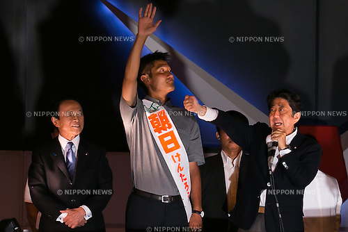 (L to R) Finance Minister Taro Aso, LDP candidate Kentaro Asahi and Shinzo Abe, leader of the Liberal Democratic Party and Prime Minister of Japan, campaign in Akihabara on July 9, 2016, Tokyo, Japan. Abe delivered his last campaign speech before the July 10th House of Councillors elections. (Photo by Rodrigo Reyes Marin/AFLO)