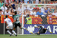 Jonathan Obika (34) of Tottenham Hotspur F. C. beats Sporting Clube de Portugal goalkeeper Rui Patricio (1) to score. Tottenham Hotspur F. C. and Sporting Clube de Portugal played to a 2-2 tie during a Barclays New York Challenge match at Red Bull Arena in Harrison, NJ, on July 25, 2010.
