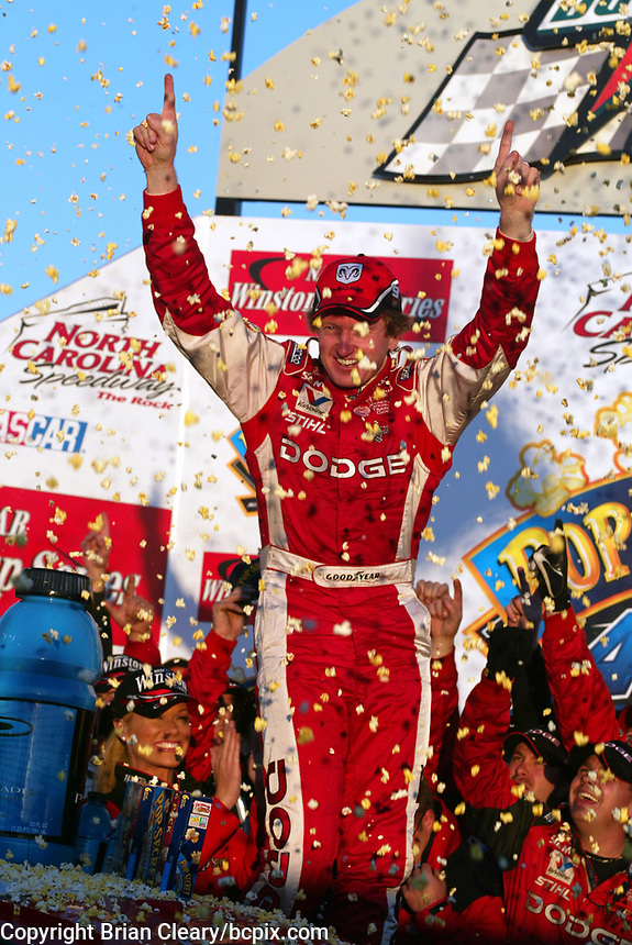 Amid flying popcorn, Bill Elliott celebrates  in victory lane after winning the Pop Secret 400 NASCAR Winston Cup race at Rockingham, NC on Sunday, November 9, 2003. (Photo by Brian Cleary)