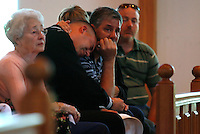 PUNTA GORDA, FL -- March 13, 2008 -- Kevin Hall cries with his son, Navy Petty Officer 2nd Class Justin Hall, as they mourn the loss fo son and brother respectively during a memorial service for former Marine Eric Hall at the Faith Lutheran Church in Punta Gorda, Fla., on Thursday, March 13, 2008.  Hall went missing on Feb. 3 after having a flashback to his time in Iraq, and was found dead weeks later by the Vietnam veteran volunteers in a culvert.