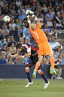 Kei Kamara (23) forward Sporting KC beats Matt Reis to the ball..Sporting Kansas City and New England Revolution played to a 0-0 tie at LIVESTRONG Sporting Park, Kansas City, KS.