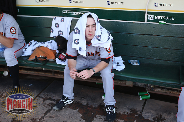 OAKLAND, CA - JUNE 23:  Tim Lincecum #55 of the San Francisco Giants gets ready in the dugout before the game against the Oakland Athletics at the Oakland-Alameda County Coliseum on June 23, 2009 in Oakland, California. Photo by Brad Mangin