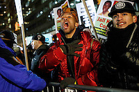 A man demonstrate outside of City Hall against police violence as another group attend a rally in support of the New York Police Department (NYPD)  in New York December 19,2014 . Kena Betancur/VIEWpress
