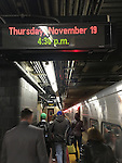 NYC, NY, USA. 19th Nov. 2015. At Penn Station, crowds of people are boarding a Rush Hour LIRR (Long Island Rail Road) eastbound train to Wantagh, the day after an ISIS propaganda video came out threatening New York City. NYC's Mayor and Police Commissioner both said there is no specific and credible threat against New York City.