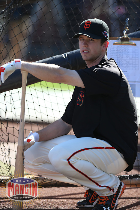 SAN FRANCISCO - OCTOBER 14:  Buster Posey of the San Francisco Giants takes batting practice before Game 1 of the NLCS against the St. Louis Cardinals at AT&T Park on October 14, 2012 in San Francisco, California. (Photo by Brad Mangin)