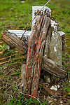 An old cross sits in the grass at a cemetery in Nebaj, Western Highlands, Guatemala