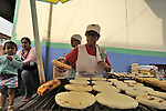 Street scenes.Salento, ColombiaCooking Arrepas on a street grill.Salento, Colombia