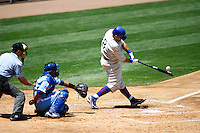 4 May 2011:# 18 Geovany Soto hits the ball in the 6th inning while the Cubs defeated the Dodgers 5-1 during a Major League Baseball game at Dodger Stadium in Los Angeles, California.  Dodgers players are wearing Brooklyn Dodger 1940's throwback jersey uniforms and the Cubs are also wearing throwback retro jersey uniforms. **Editorial Use Only**