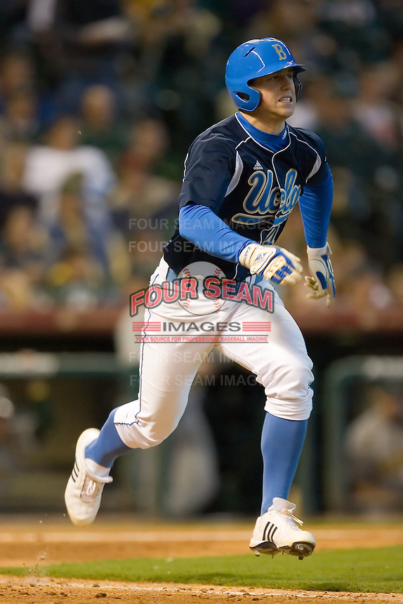 Chris Giovinazzo #49 of the UCLA Bruins hustles down the first base line versus the Baylor Bears in the 2009 Houston College Classic at Minute Maid Park February 28, 2009 in Houston, TX.  The Bears defeated the Bruins 5-1. (Photo by Brian Westerholt / Four Seam Images)