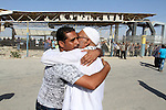 A Palestinian man welcomes his pilgrim relative at the Rafah crossing between Gaza Strip and Egypt after performing the annual Hajj, in Rafah in southern Gaza Strip, September 30, 2015. Around 500 Hajj pilgrims cross Rafah crossing on Wednesday following Egyptian authorities allow Hajj pilgrims to cross into Gaza Strip. Photo by Abed Rahim Khatib