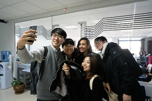 """Palestine, Ramallah, Jan 2017. Students of Handong University of Korea doing a """"selfie"""" with Samar Youssef, program coordinator of the Fast-forward accelerator, the first Accelerator in Palestine During the program called """"Global Business Expedition"""" they visit world-famous companies– to learn more about achievements of the corporations and latest developments in corporate governance."""