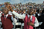 Just before the one-year anniversary of the January 2010 earthquake that ravaged Port-au-Prince, Haiti, this man joined with thousands of others in the capital's soccer stadium for a religious gathering that featured Franklin Graham, the conservative U.S. evangelical leader..