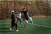 BIARA, IRAQ: When the weather is good, the students hold football matches with young men from nearby villages...The Biara Madrassa--a religious school--is located high up in the mountainous Kurdish Hawraman region that makes up the Iran/Iraq border. Before 2003 the region was home to a fundamentalist Islamic group called Ansar al-Islam who used the school as a base. The Unites States military attacked the area and the madrassa numerous times during the 2003 invasion, finally pushing Ansar al-Islam out...Today the madrassa is home to 48 male students from all across Kurdish Iraq. The students leave their families and immerse themselves in their studies and the daily life of Koranic students...Photo by Besaran Tofiq