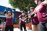 Members of the Peninsula Roller Girls do a team chant after a demonstration for spectators at the Los Altos Stride and Ride event July 27.