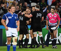 Ben Smith of New Zealand is congratulated on his try. Rugby World Cup Pool C match between New Zealand and Namibia on September 24, 2015 at The Stadium, Queen Elizabeth Olympic Park in London, England. Photo by: Patrick Khachfe / Onside Images