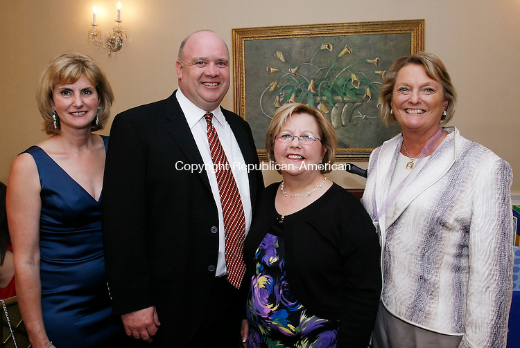 WATERBURY, CT, 05/08/09- 050809BZ18- From left- Carrie Zimeski-Sullivan, Keith Sullivan, recipient of the Gregory and Dabina Lines Service Award, Mary Ellen Hadelman, and Kathy Berman, co-president of the board of Literacy Volunteers of Greater Waterbury <br /> during the &quot;In Good Taste&quot; wine dinner and auction at the Country Club of Waterbury Friday night.<br /> Jamison C. Bazinet Republican-American