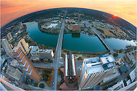 From way up high over Austin, Texas, this January sunset photograph uses a fisheye lens to show Lady Bird Lake, Zilker Park, and the south Austin area.