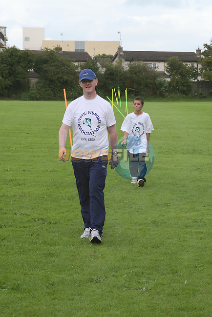 Gerard Fay with his nephew Kader Guemboura as Gerard walks around the football pitch for 24 hours in aid of Cystic Fibrosis...Photo NEWSFILE/Jenny Matthews.(Photo credit should read Jenny Matthews/NEWSFILE)....This Picture has been sent you under the condtions enclosed by:.Newsfile Ltd..The Studio,.Millmount Abbey,.Drogheda,.Co Meath..Ireland..Tel: +353(0)41-9871240.Fax: +353(0)41-9871260.GSM: +353(0)86-2500958.email: pictures@newsfile.ie.www.newsfile.ie.FTP: 193.120.102.198.