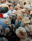 United States President George H.W. Bush shares a Thanksgiving holiday meal with US military personnel in Saudi Arabia on November 22, 1990.<br /> Mandatory Credit: Ed Bailey / DoD via CNP