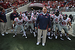 Ole Miss head coach Houston Nutt leads the Rebels onto the field vs. Arkansas at Reynolds Razorback Stadium in Fayetteville, Ark. on Saturday, October 23, 2010. Arkansas won 38-24.