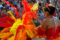 Colombian girls, having an orange feather costume, dance during the Carnival in Barranquilla, Colombia, 26 February 2006. The Carnival of Barranquilla is a unique festivity which takes place every year during February or March on the Caribbean coast of Colombia. A colourful mixture of the ancient African tribal dances and the Spanish music influence - cumbia, porro, mapale, puya, congo among others - hit for five days nearly all central streets of Barranquilla. Those traditions kept for centuries by Black African slaves have had the great impact on Colombian culture and Colombian society. In November 2003 the Carnival of Barranquilla was proclaimed as the Masterpiece of the Oral and Intangible Heritage of Humanity by UNESCO.